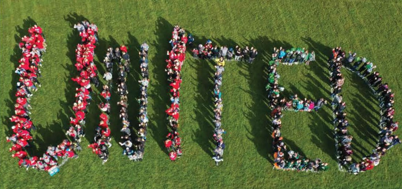 "Photo of 2019 Walk United walkers spelling out the word ""United."""